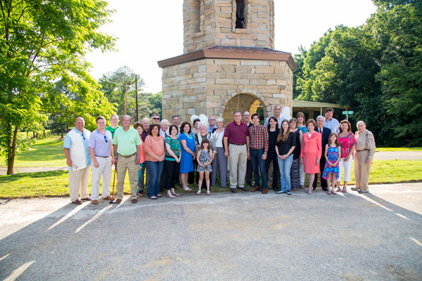 Family and friends in front of the Amber Buckley Lyons Memorial Bell Tower