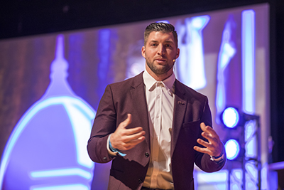 Tim Tebow speaks at the annual benefit dinner, helping to raise more than $1.3 million for scholarships at FHU.