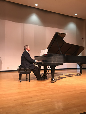 "Dr. Richard England performs his original piano ""sketches"" at the 40th annual conference of the College Music Society Southern Chapter."