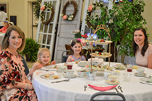 Chasity Burns and her daughter Anna Kate, along with Sara Wood and daughter Emma enjoy the 2018 Victorian Tea Party.