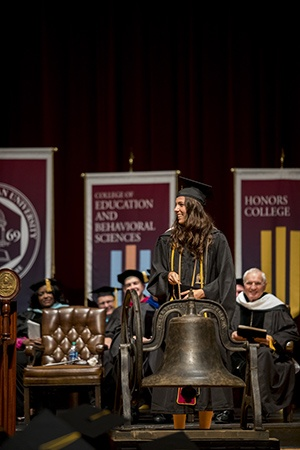 Alex Britt, winner of the Faculty Scholarship-Leadership Medal, tolls the bell to end not only the 2018 commencement exercises, but also the 2017-18 academic year.