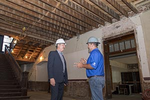 FHU President David Shannon talks with Ryan Burris, Alliance job superintendent, about the restoration of Old Main.