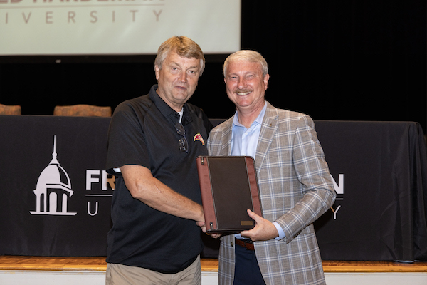FHU President David R. Shannon honors Mike McCutchen for 35 years of service to the university.
