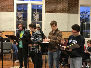 """Members of FHU Chorale rehearse for the upcoming presentation of """"Shepherd of the Hills,"""" an original musical by Dr. Alan Kinningham."""