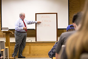Dr. John Simmons, Columbia, Tennessee, physician, discusses bioethics with FHU students majoring in the health arts.