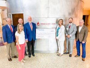 Pictured (left to right) in the check presentation are Steve Baggett, Suzanne Gillson, Dr. Chris White, Dr. Bob Spencer, Gina Bullington, Jason Boyd, and Dave Clouse.